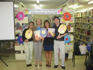 Miss Anna Maria (c-right) and her wonderful library staff.