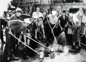Sailors scrubbing radiation.